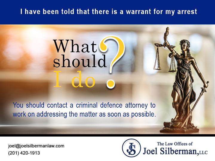 I have been told that there is a warrant for my arrest. What should I do?